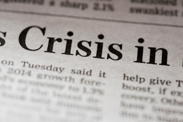 Newspaper with the word Crisis