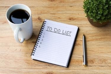 To Do List with a cup of coffee and a pen