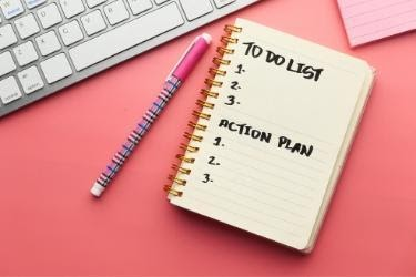 Notebook with a To Do List and an Action Plan List