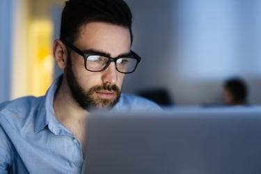 Man focused on the computer screen