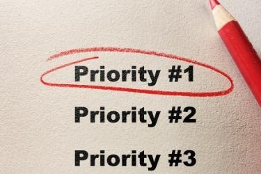 "Paper with the word ""Priority #1"" circled in red"