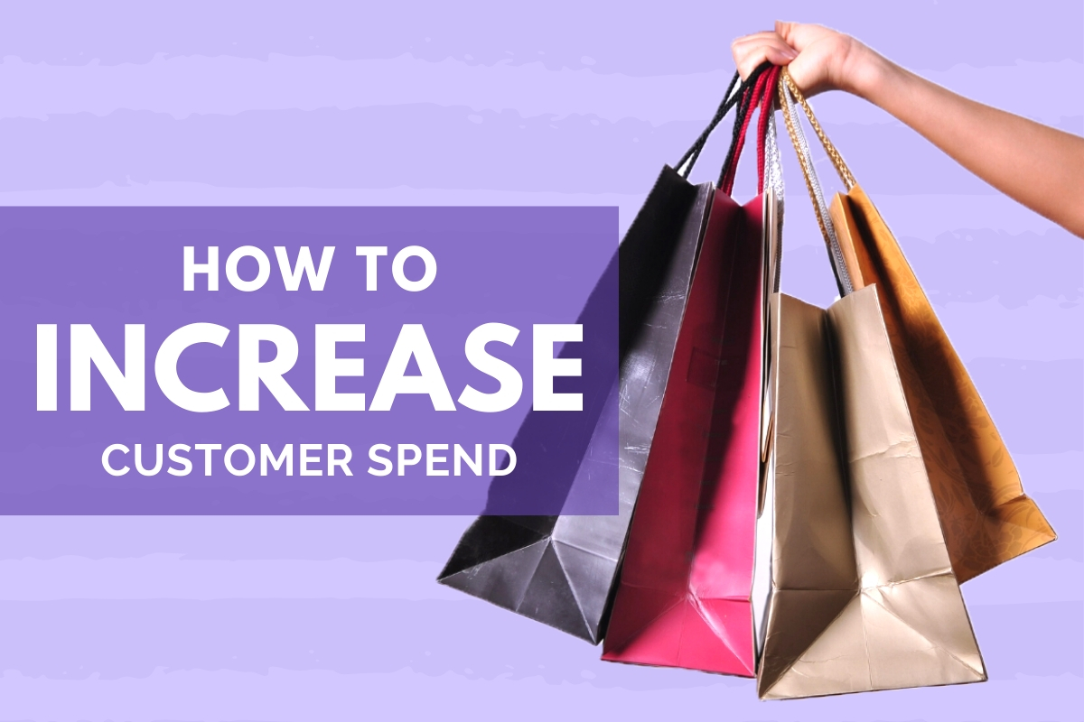 How to Increase Customer Spend - Hand with shopping bags