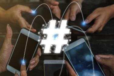 Hashtag concept - Mobiles Connected through #