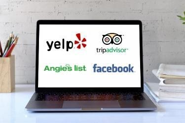 Laptop with Yelp, Tripadvisor, Angie's List and Facebook Logo.