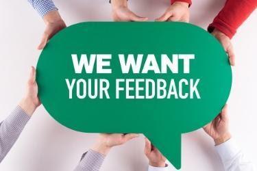 """""""We want your feedback"""" written in a green speech bubble"""