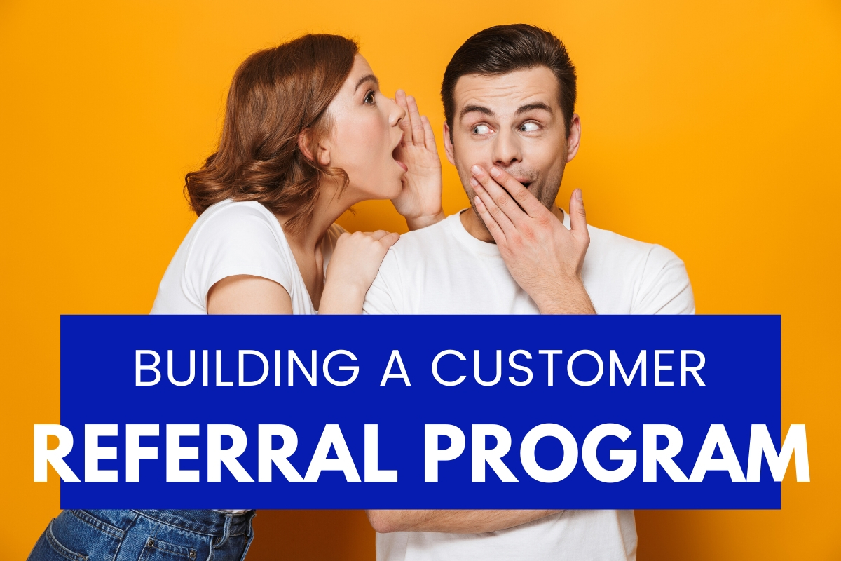 Building a Customer Referral Program - Woman whispering something in a man's ear