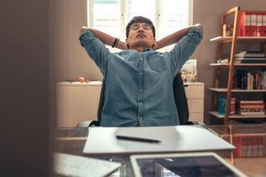 Man taking a break to stretch