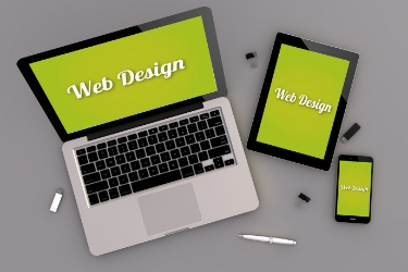 Responsive Webpage shown on a laptop, tablet and mobile.