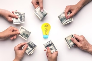Crowdfunding - many people giving money to an idea