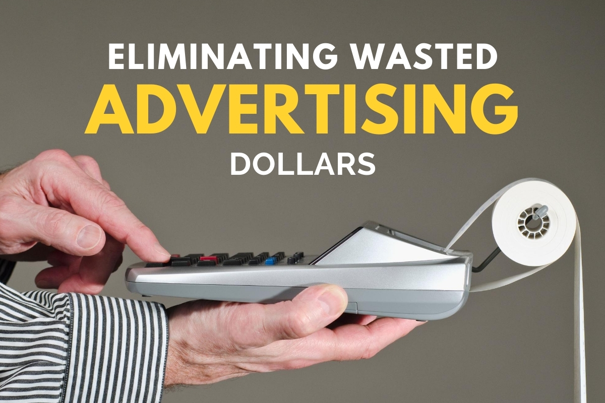 Man's hands using a calculator - Eliminating Wasted Advertising Dollars