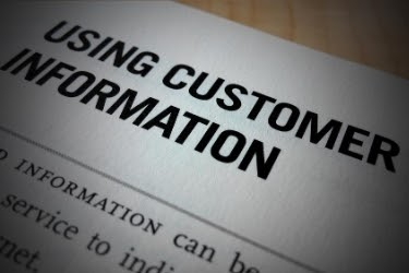 Paper with the words: Using Customer Information