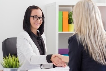 Woman shaking hands with a professional