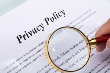Magnifying glass on a Privacy Policy document