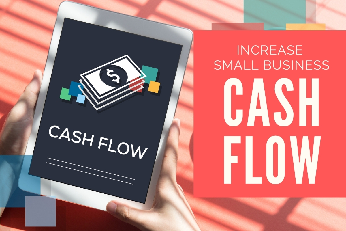 "Hands holding a tablet with the words ""Cash Flow"" - Increase Small Business Cash Flow"
