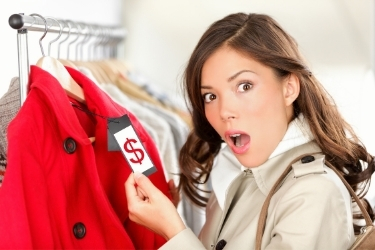Woman looking at a price tag
