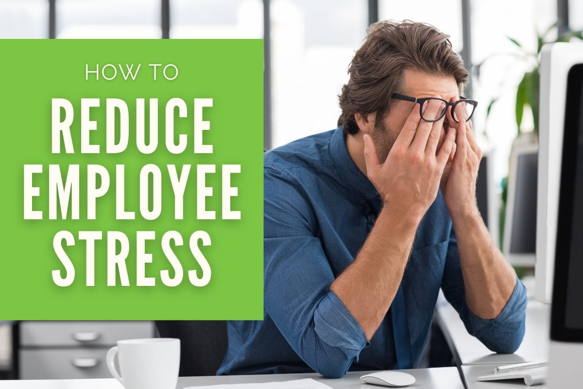 Man showing signs of stress - How to Reduce Employee Stress