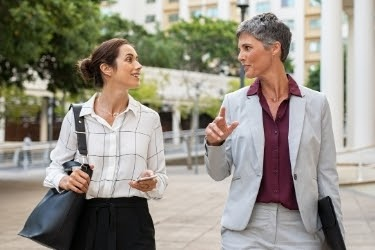 Woman listening to another woman speak