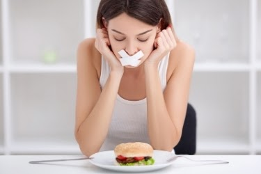 Woman avoiding her food