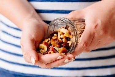 Hands full of nuts