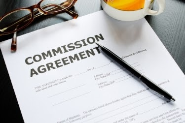"Paper with the words ""Commission Agreement"""