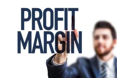 """Man writing """"Profit Margin"""""""