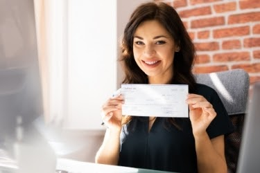 Woman holding a check