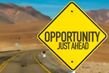 "Traffic sign that says ""Opportunity Just Ahead"""