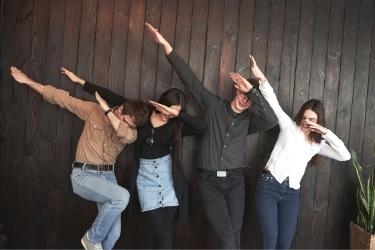 Four people dabbing for fun