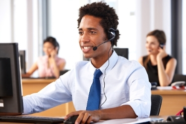 Professional man with headset working as a virtual assistant