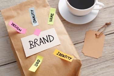 """Branding Concept - Paper bag with sticky notes that says """"Brand, Design, Quality, Name, Logo and Identity"""""""