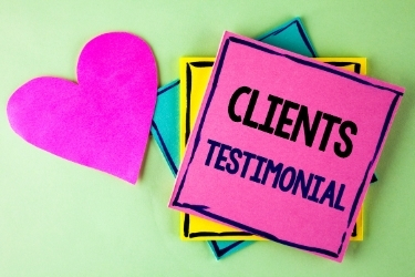 """Sticky note with the words """"Clients Testimonials"""""""