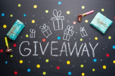 """""""Giveaway"""" with gifts surrounding the word"""