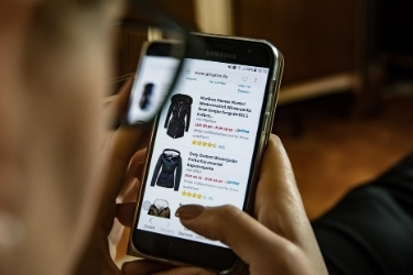 Person shopping for clothes on a mobile e-commerce website
