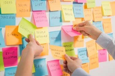People brainstorming with sticky notes.
