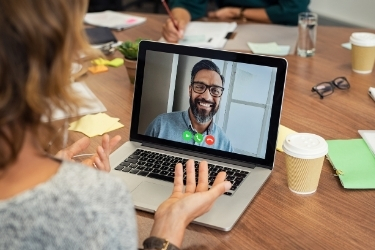 Woman talking to her manager through a video call