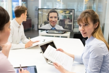Small team working together with a remote coworker