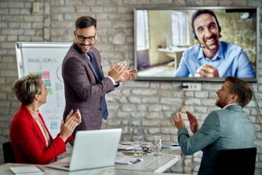 Team applauding to a remote coworker