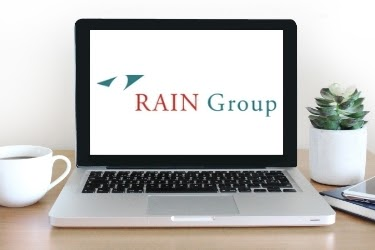 RAIN Group logo in a laptop screen