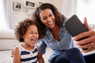Mother doing livestream with her child
