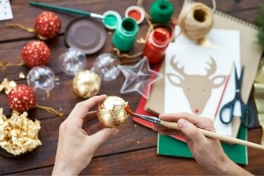 Hands doing Christmas crafting