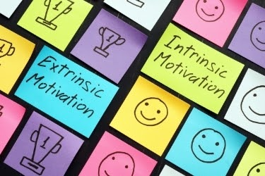 """""""Extrinsic Motivation"""" with trophies vs """"Intrinsic Motivation"""" with smiley face"""