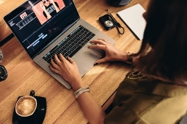 Woman editing a video on her laptop