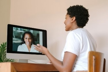 Woman doing a video conference with her manager