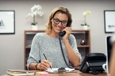 Woman doing sales through phone