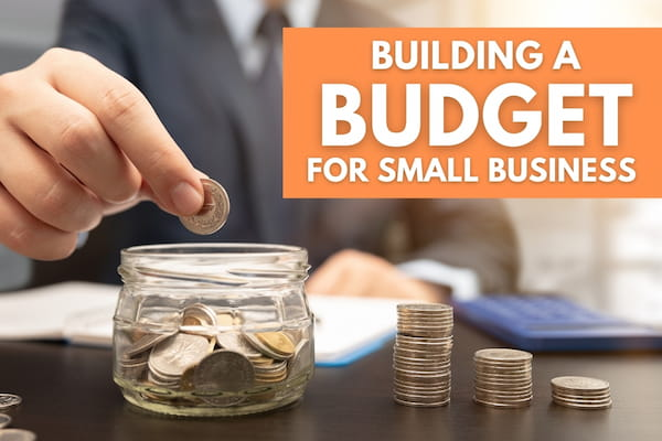 Man putting a coin inside a jar - Building a Budget for Small Business