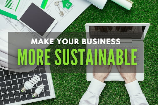 Man using a laptop surrounded with eco-friendly devices - Make your business more sustainable