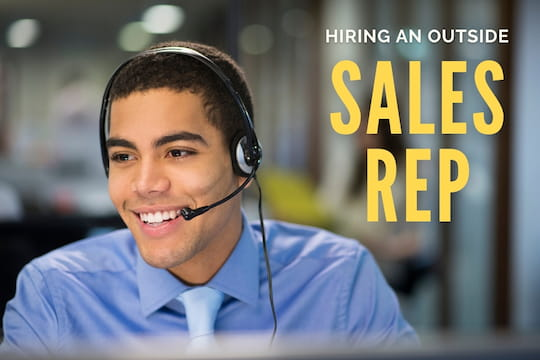 Salesman with a headset - Hiring an Outside Sales Rep