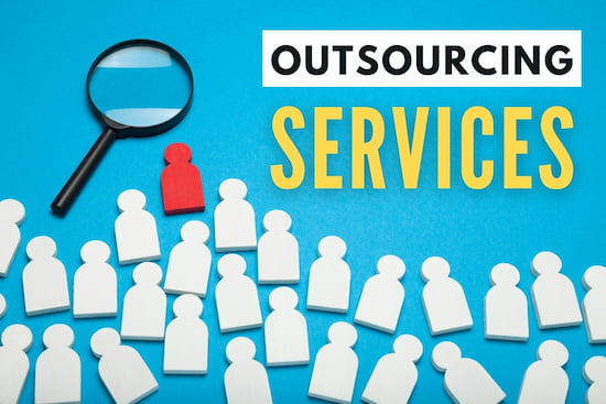 A lot of cutouts shaped as human with one being red, and a magnifier - Outsourcing Services