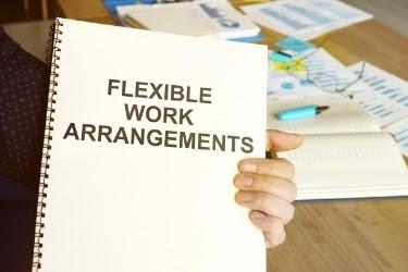 """Hands holding a """"Flexible Work Arrangements"""" book"""