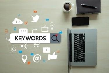 Keywords next to a laptop